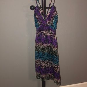 Multi color dress. With adjustable straps.